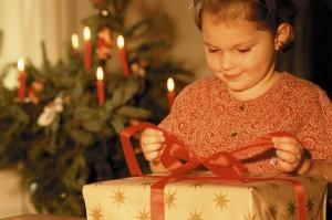 Girl Opening Christmas Present