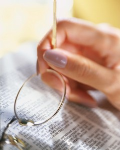 Holding Glasses over Bible